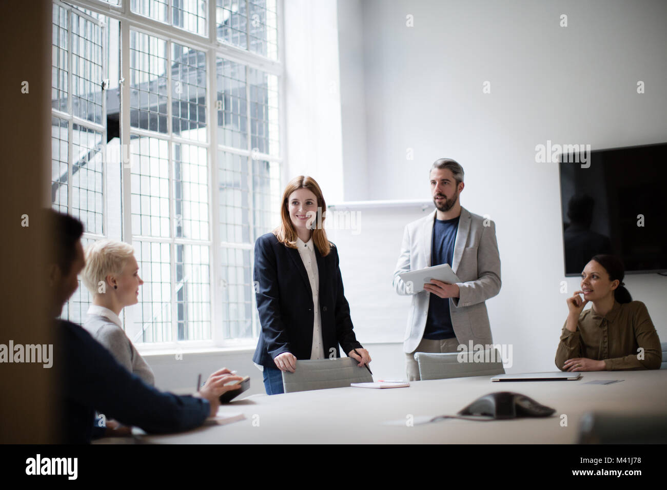 Business executives leading a brainstorm meeting - Stock Image