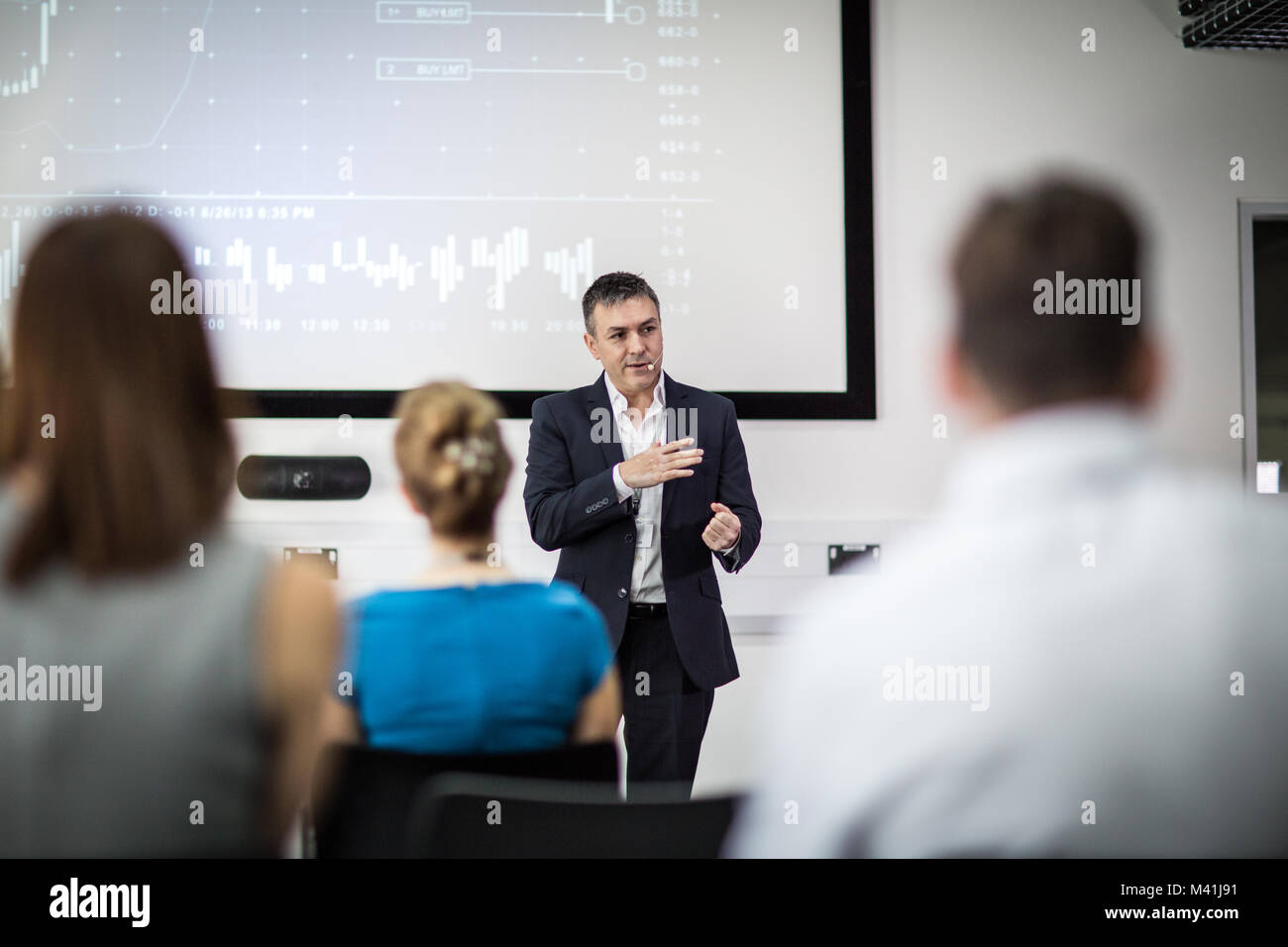 Businessman leading a training conference - Stock Image
