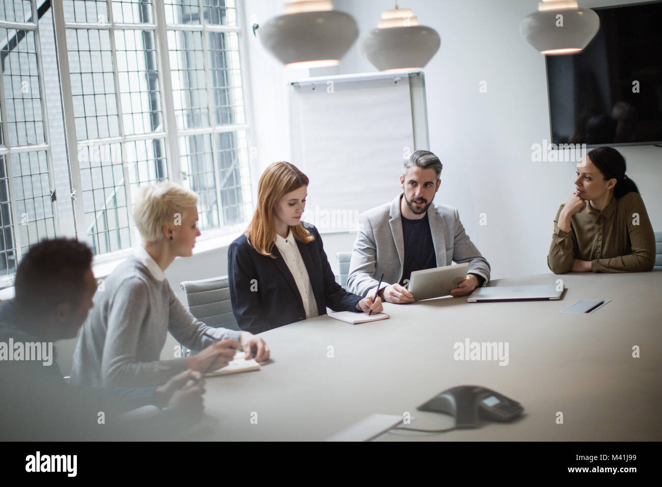Male business executive leading a meeting Stock Photo