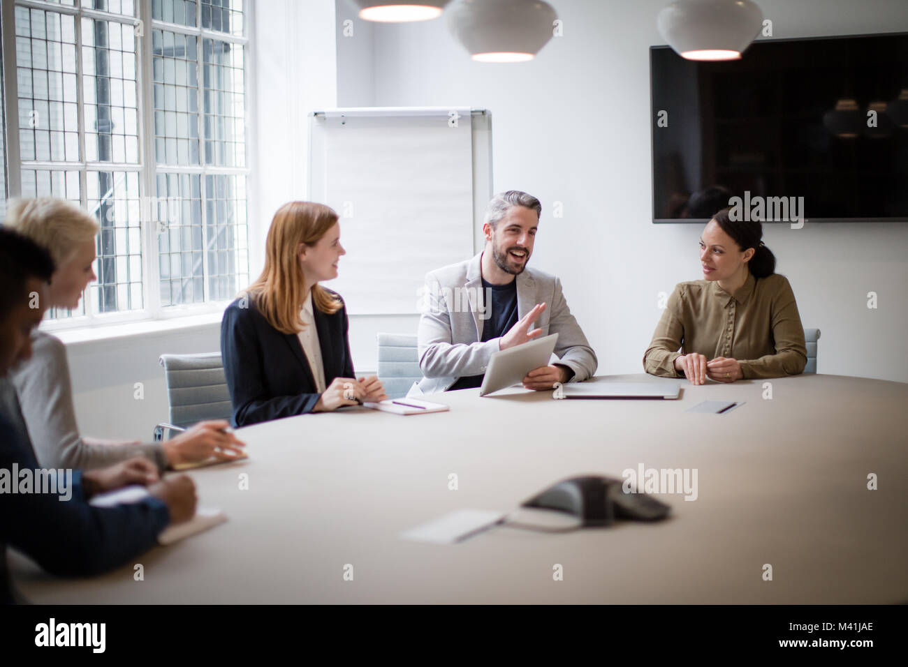 Male business executive leading a meeting - Stock Image