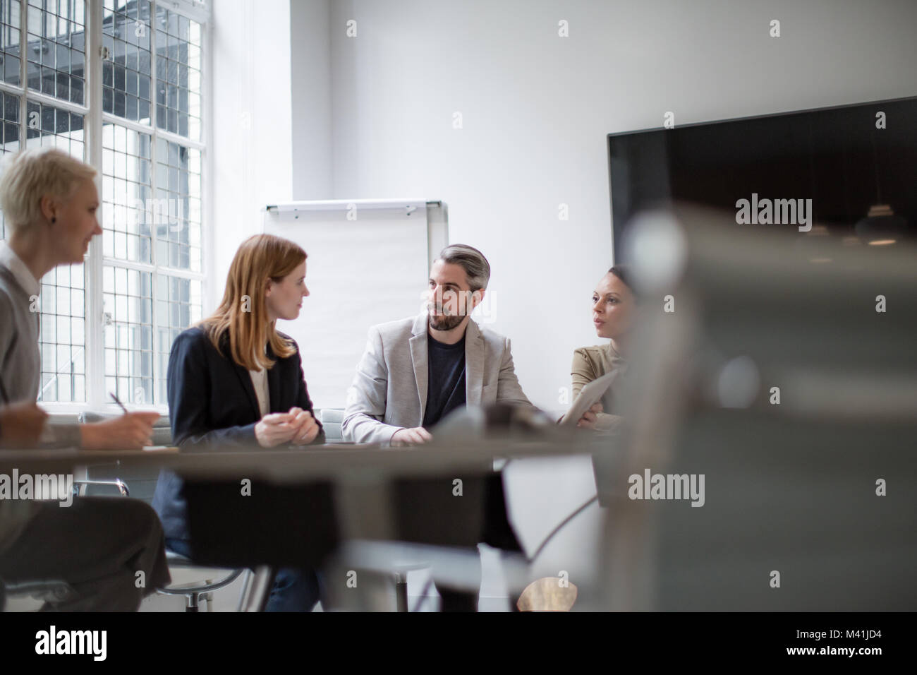 Business executives in a team meeting - Stock Image
