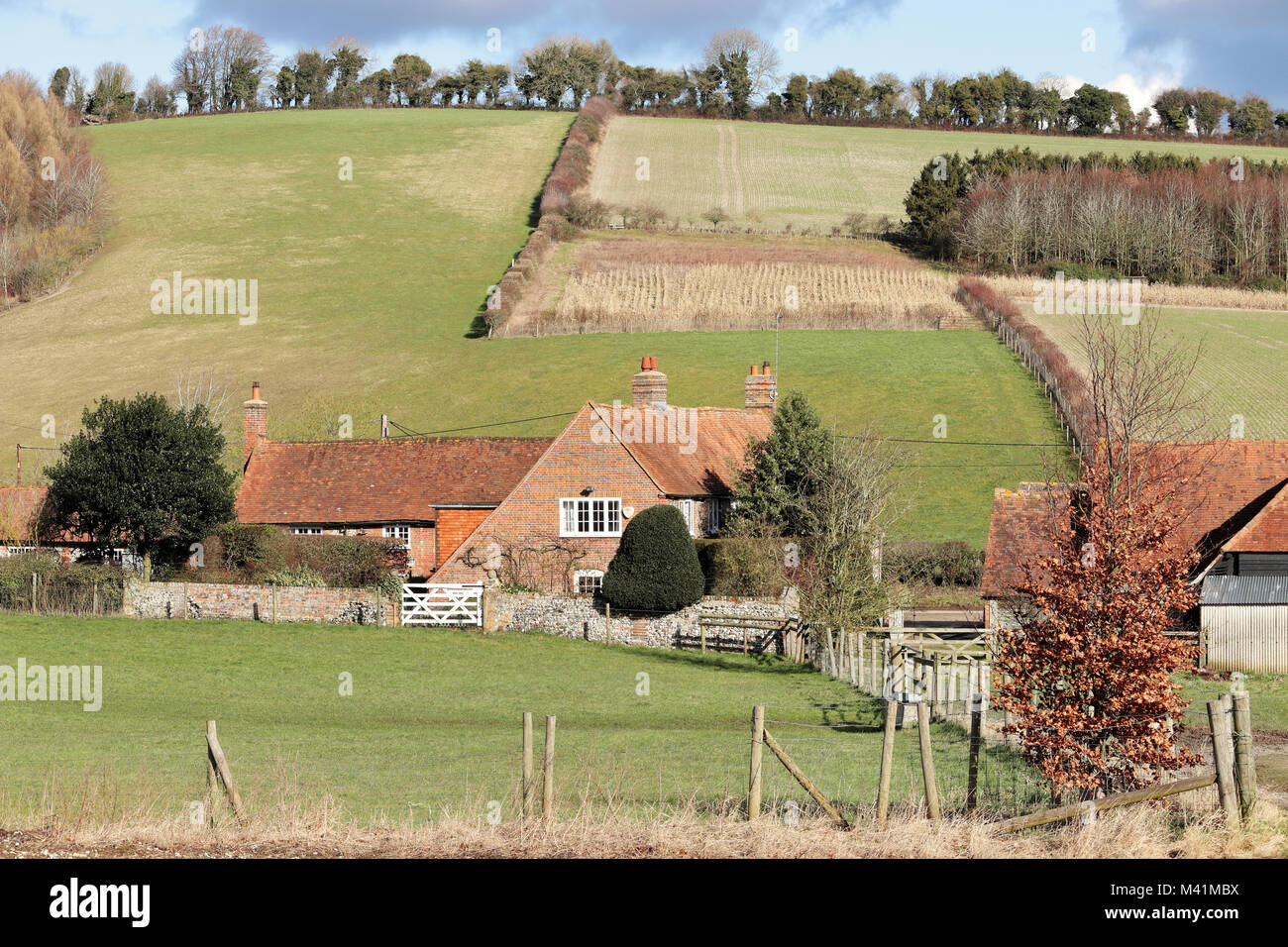 An English Rural Landscape in the Chiltern Hills in Winter sunshine with with Farmhouse in the Valley - Stock Image
