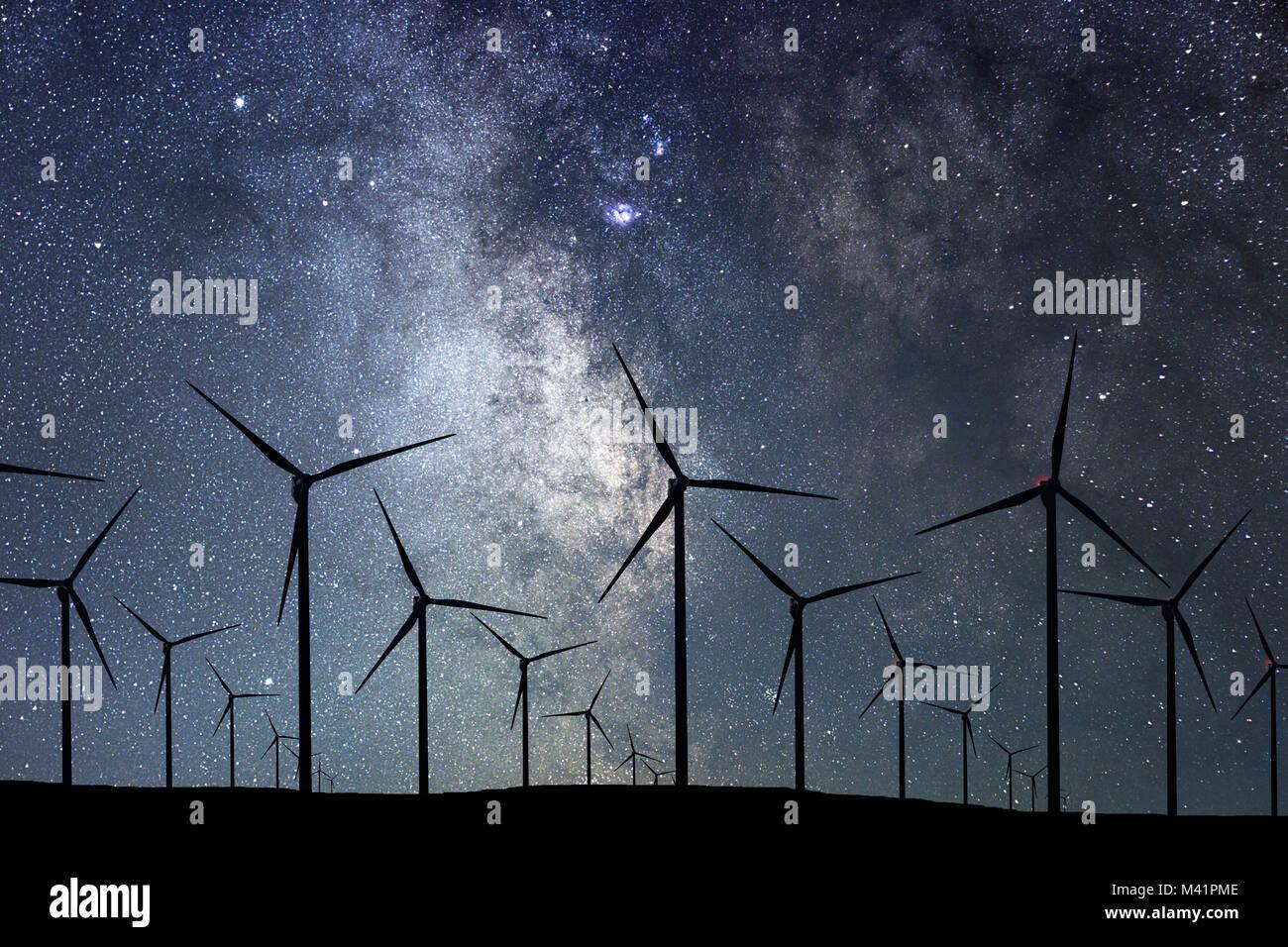 Night Sky Over Wind Farm. Energy and nature Night Sky. - Stock Image