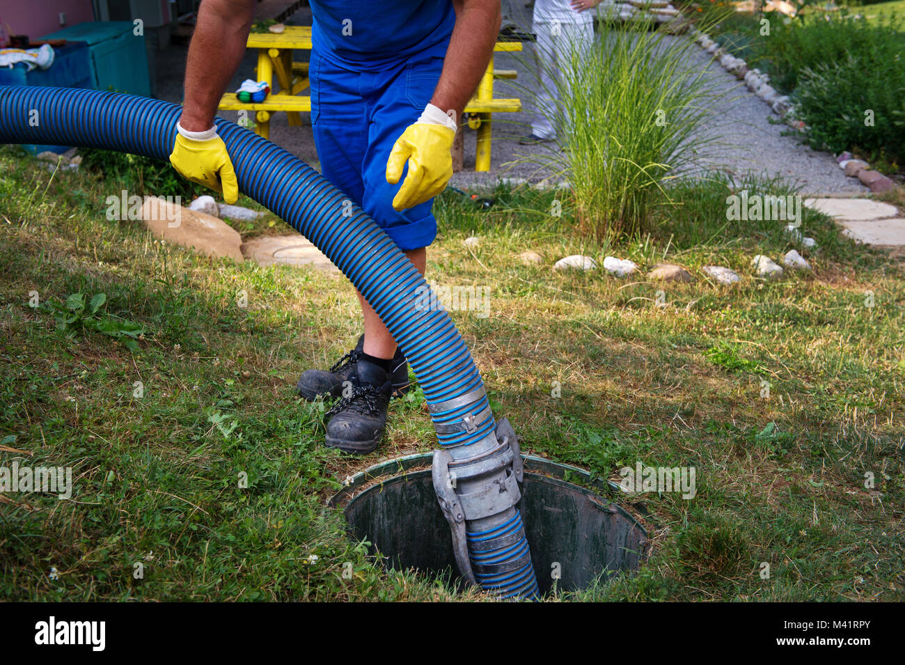 Emptying household septic tank  Cleaning sludge from septic