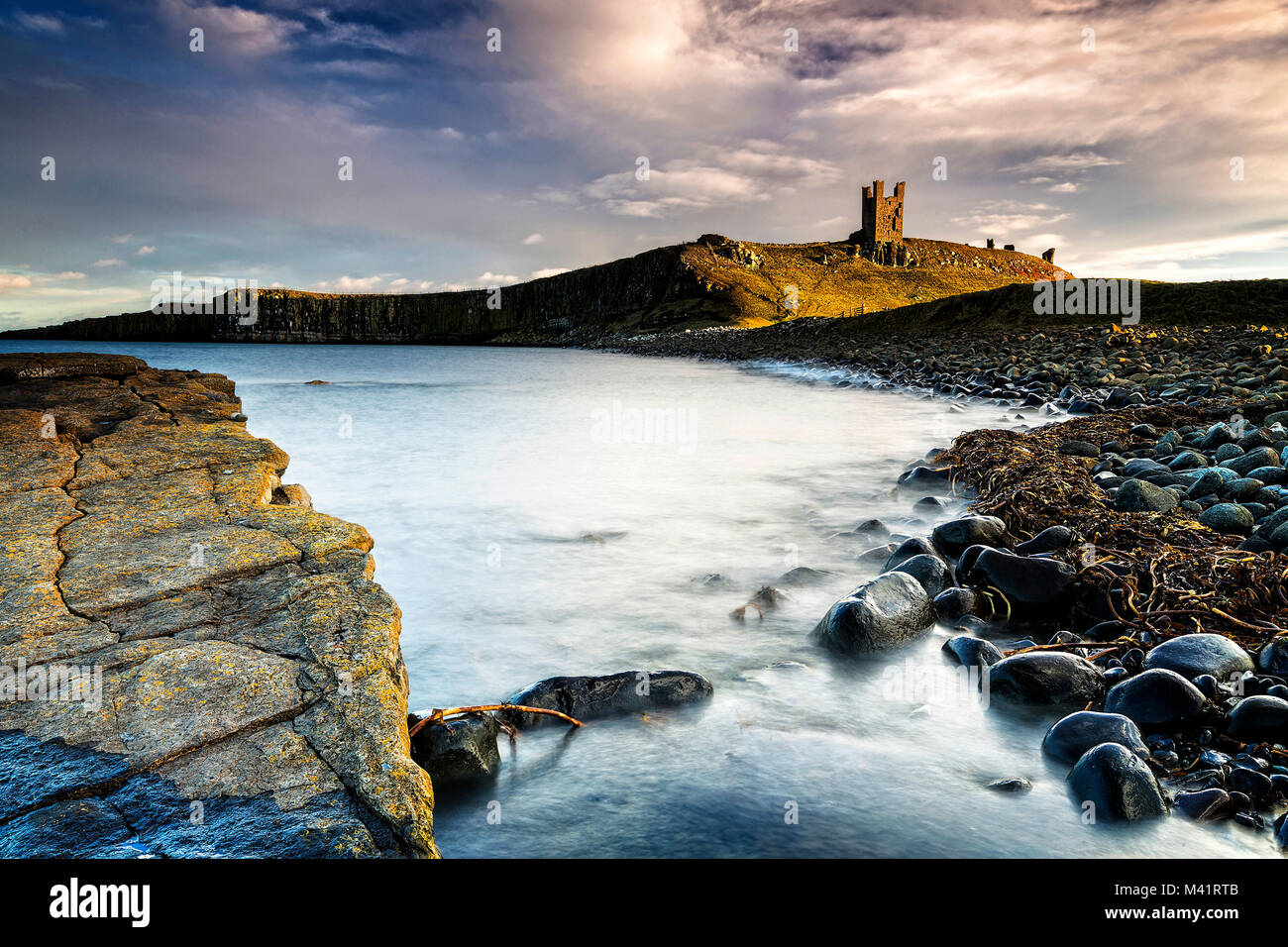 A photograph of Dunstanburgh Castle in Northumberland. Stock Photo