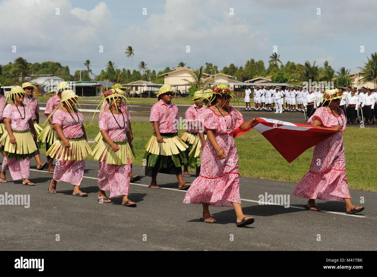 Tuvaluans parade through Funafuti during annual Independance Day celebrations - Stock Image