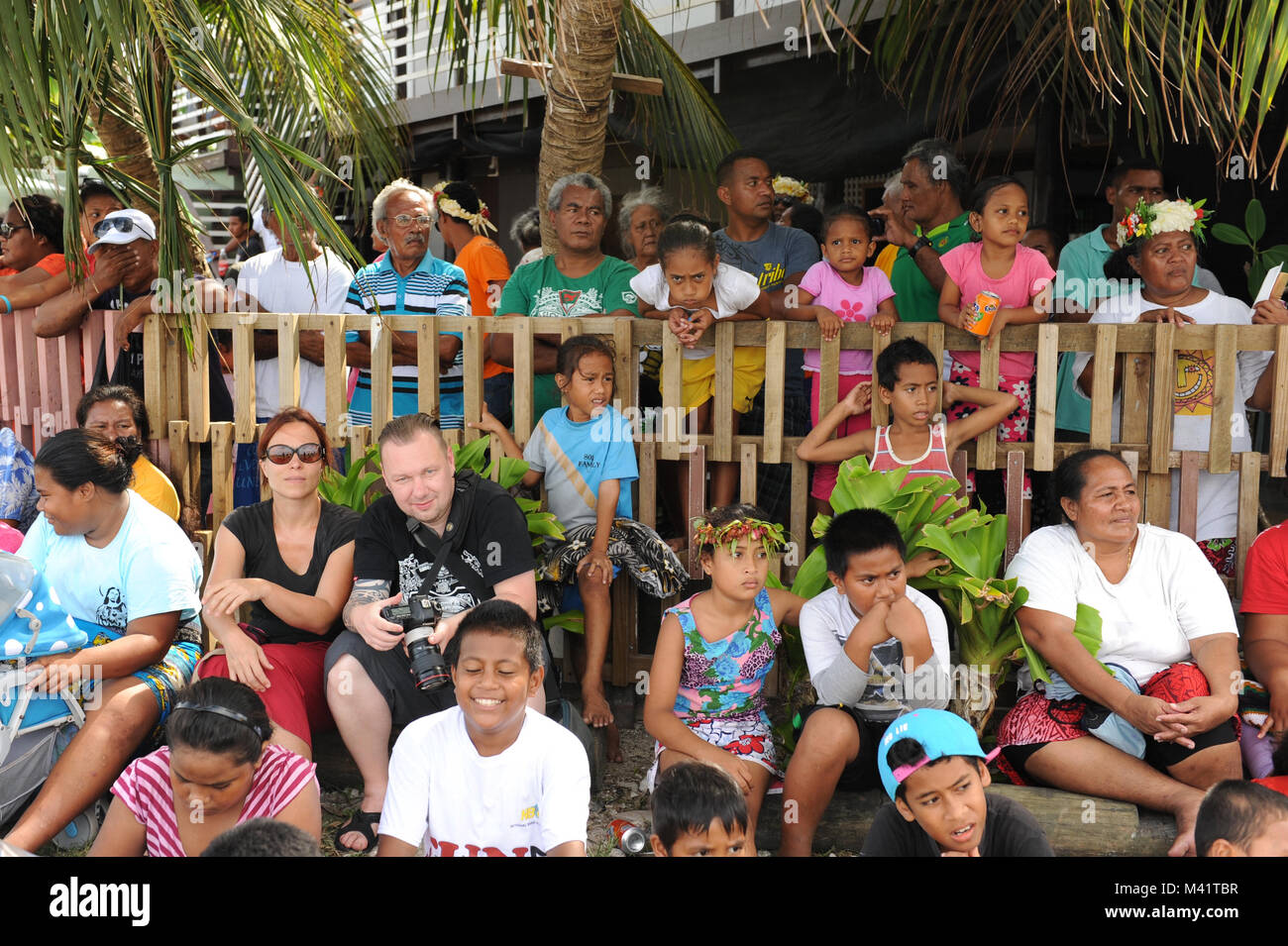 Tuvaluans and tourists watch the parade through Funafuti during annual Independance Day celebrations - Stock Image
