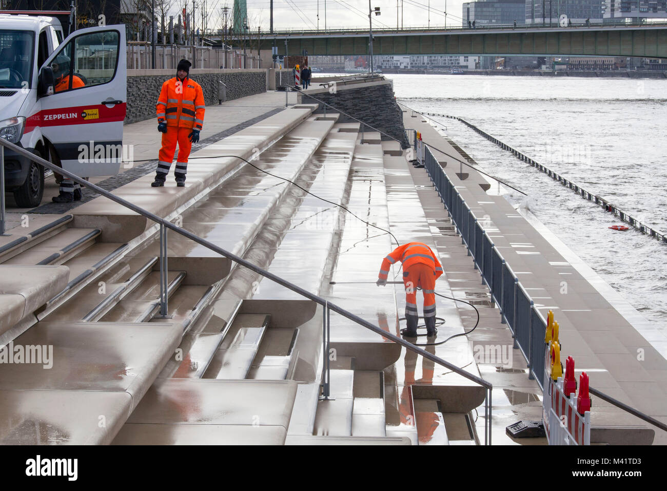 Europe, Germany, North Rhine-Westphalia, Cologne, cleaning the stairs of the Rhine boulevard in Deutz after a flood. Stock Photo