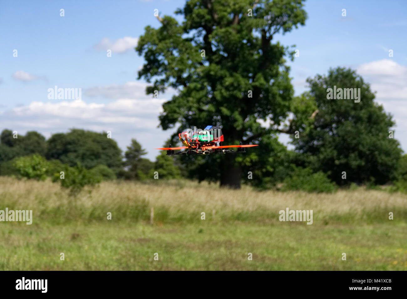 A hand built Racing Drone in flight near Bristol, England - Stock Image