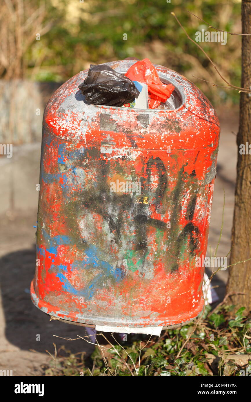 Old  Red metal Trash Can - Stock Image