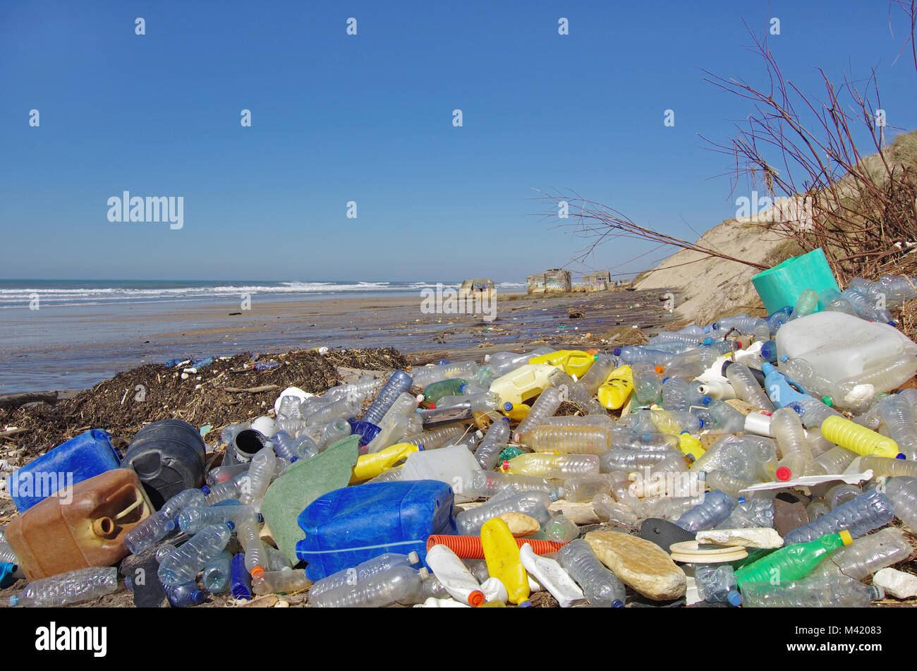 garbage, plastic, and wastes on the beach after winter storms. Stock Photo