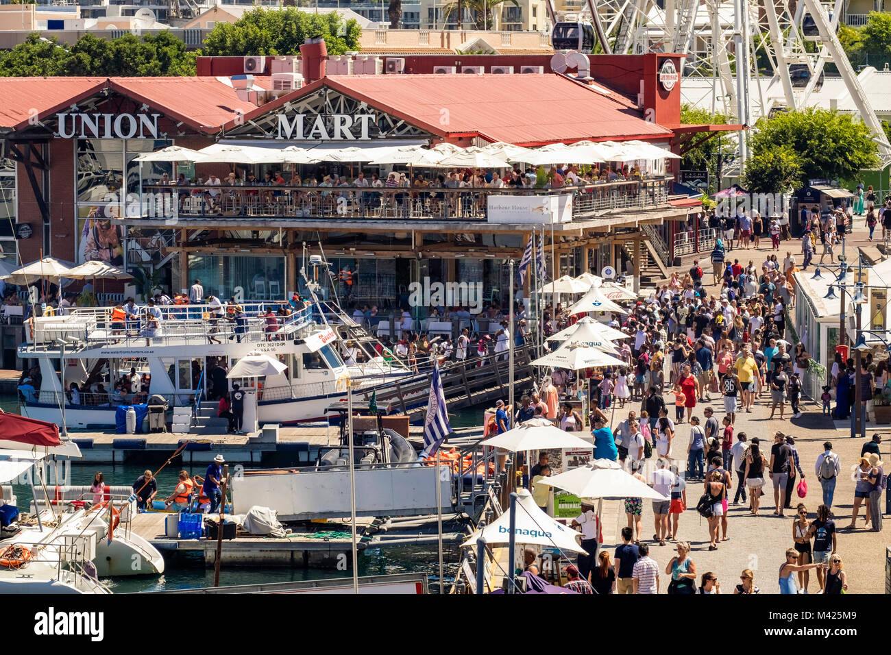 V&A Waterfront, and Cape Union Mart in Cape Town city, South Africa busy with people shopping in summer - Stock Image