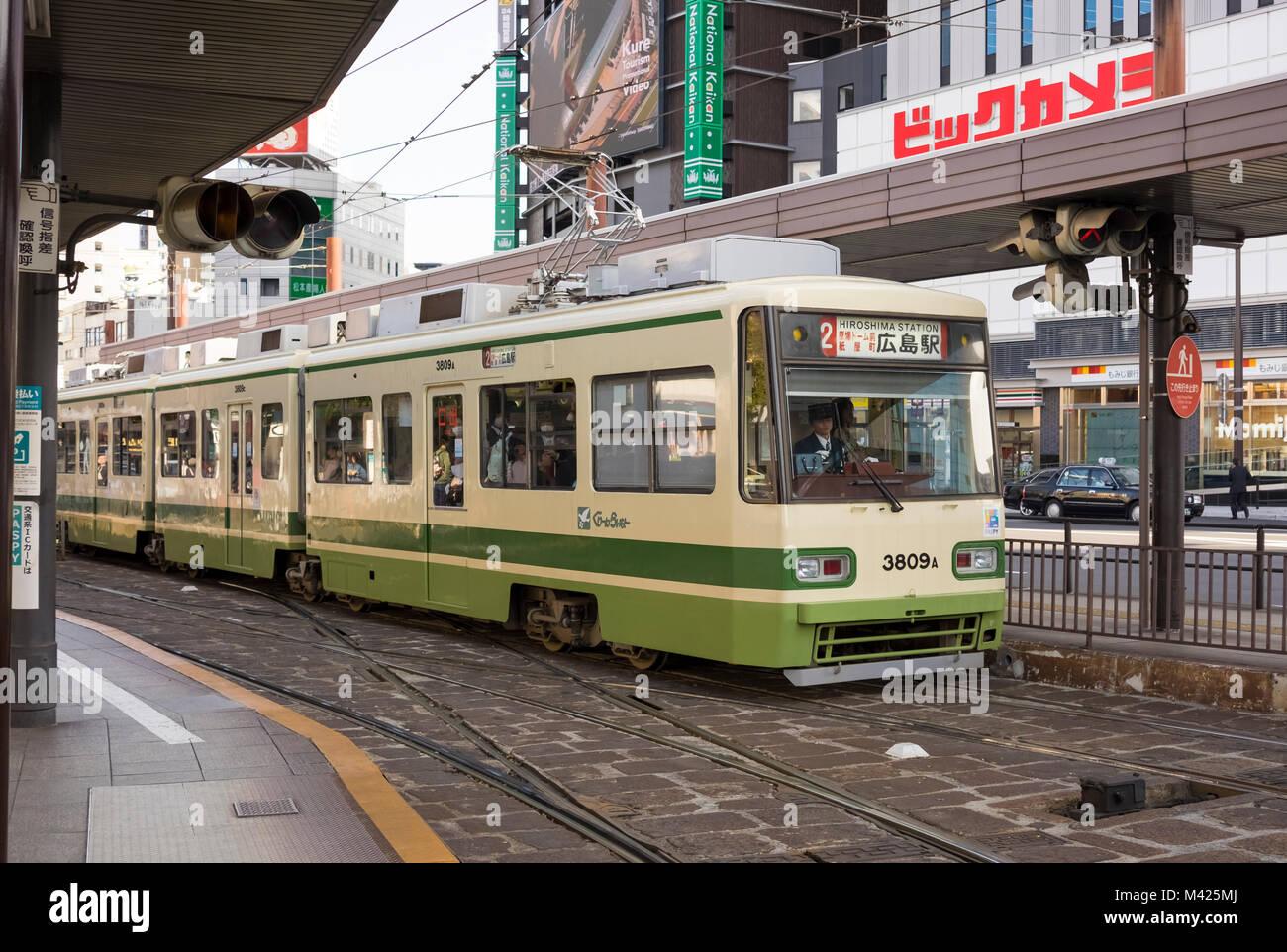 Tram in the street in Hiroshima, Japan - Stock Image