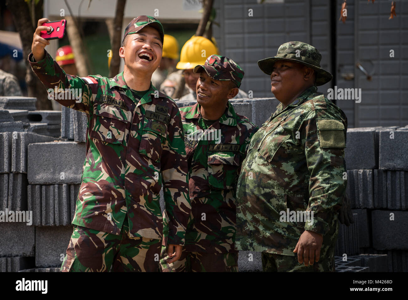 Indonesian Army soldiers take a selfie with a Royal Thai