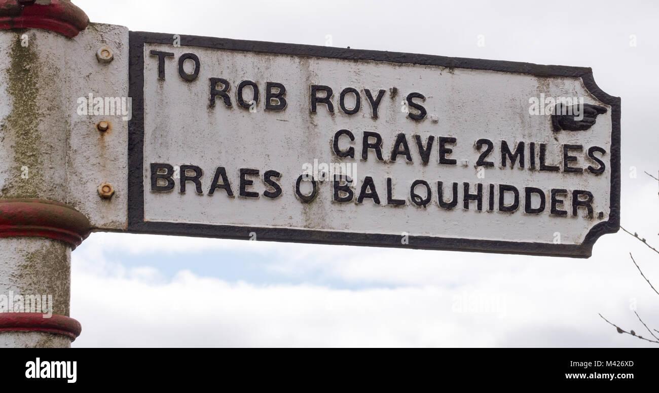 Fingerpost sign directing travellers towards Rob Roy's Grave, Balquhidder, Perthshire, Scotland, UK. Stock Photo