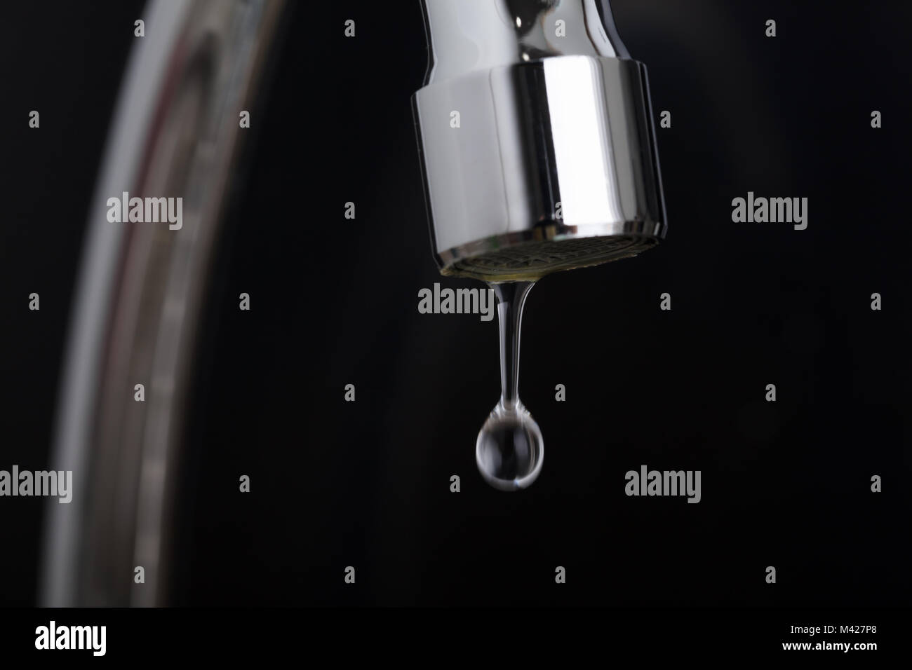 Close-up Of Leakage Tap With Dripping Water Drop - Stock Image