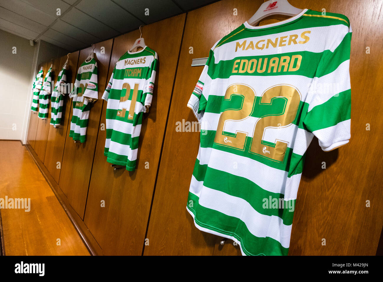 Football strips hanging inside home dressing room at Celtic Park home of Celtic Football Club in Parkhead , Glasgow, - Stock Image