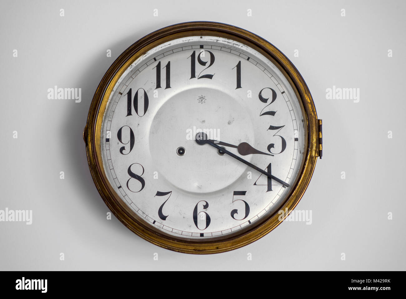 Vintage circular wall clock from the early twentieth century made by Junghans Uhren GmbH, German watch and clock - Stock Image