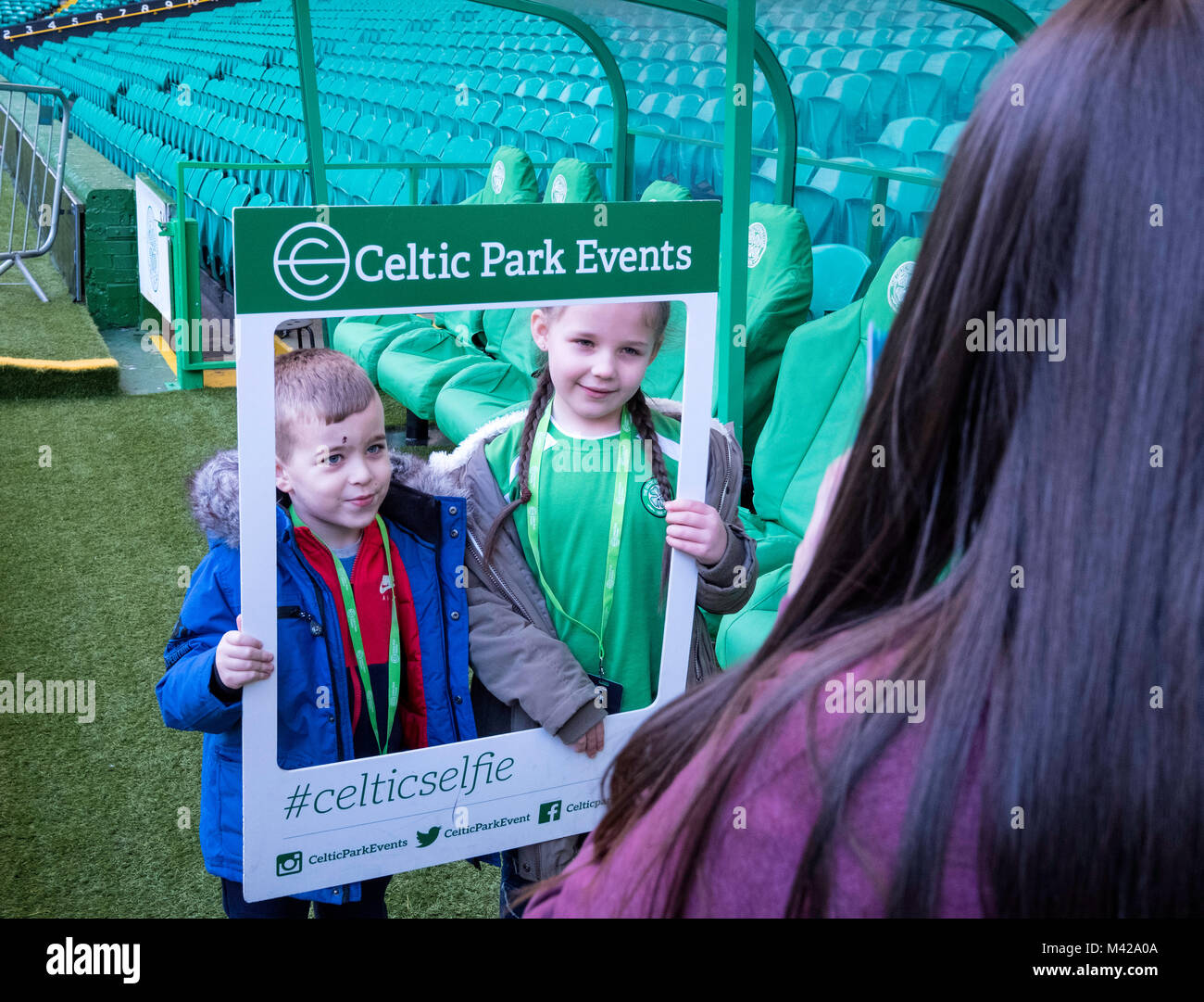 Young fans being photographed at Celtic Park home of Celtic Football Club in Parkhead , Glasgow, Scotland, United - Stock Image