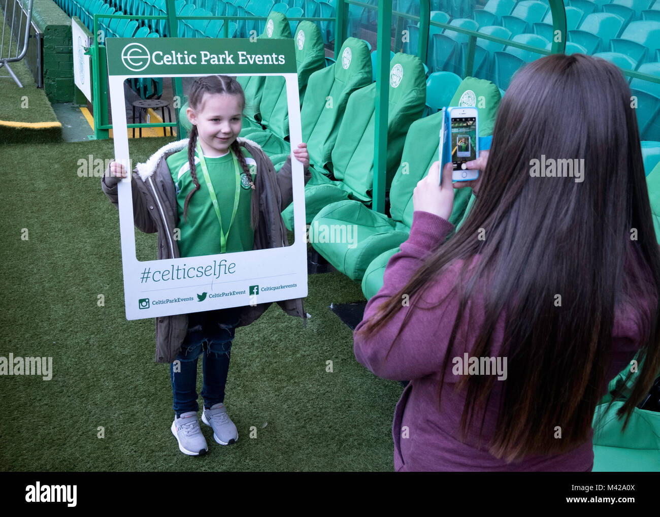 Young fan being photographed at Celtic Park home of Celtic Football Club in Parkhead , Glasgow, Scotland, United - Stock Image