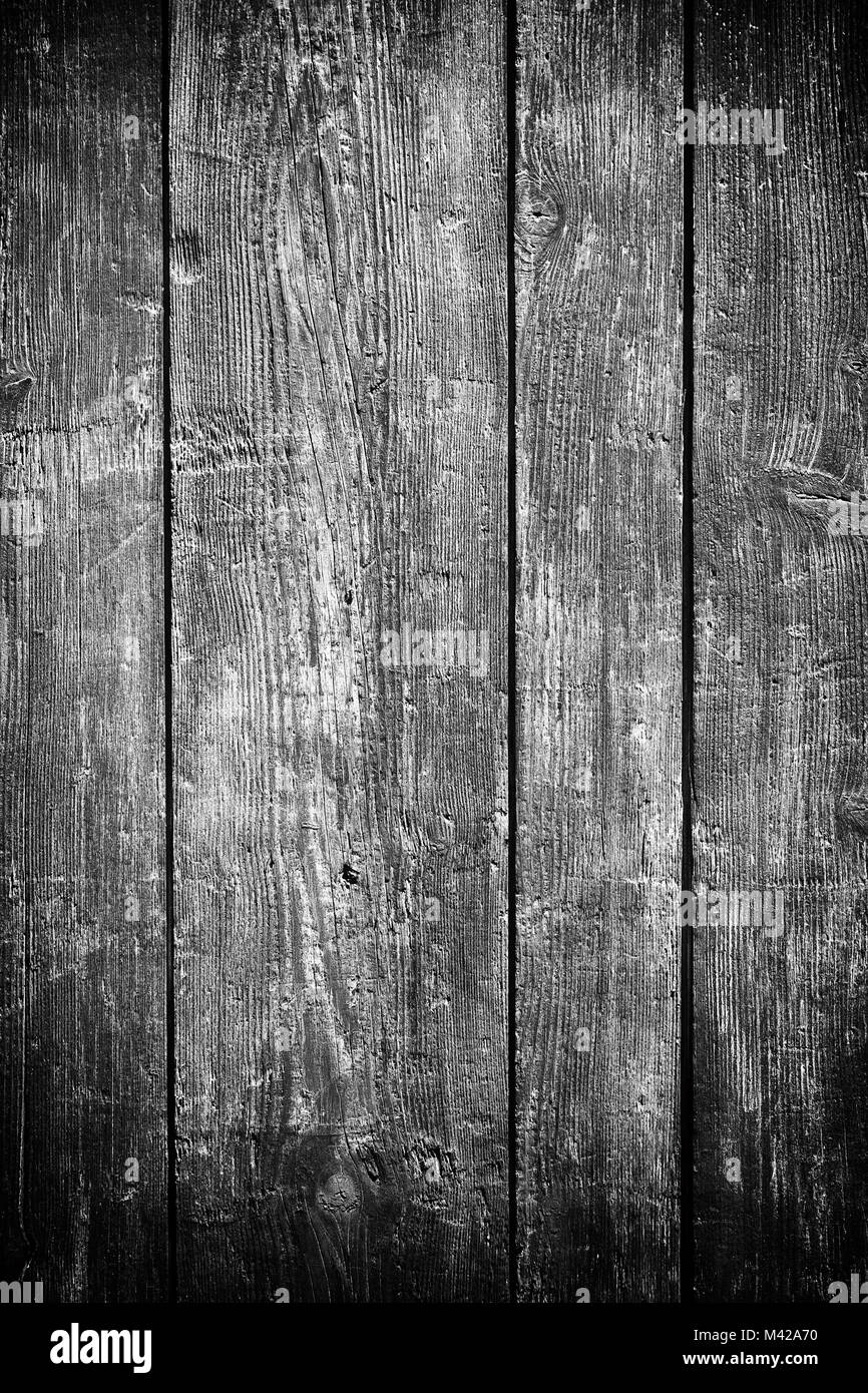 Old wooden planks surface background in black and white. Vertical shot - Stock Image