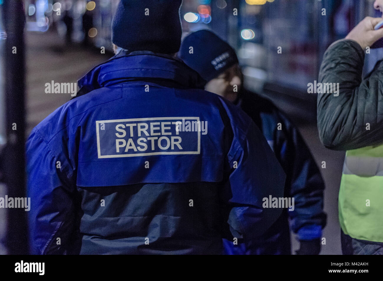 Volunteers for Christian community-focussed  charity Street Pastors, at night in Torquay, Torbay, Devon. 2018. - Stock Image