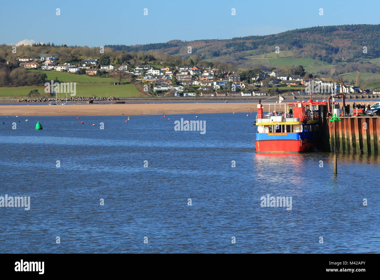 View from Exmouth beach across Exe Estuary to Cockwood, Devon, England, UK - Stock Image