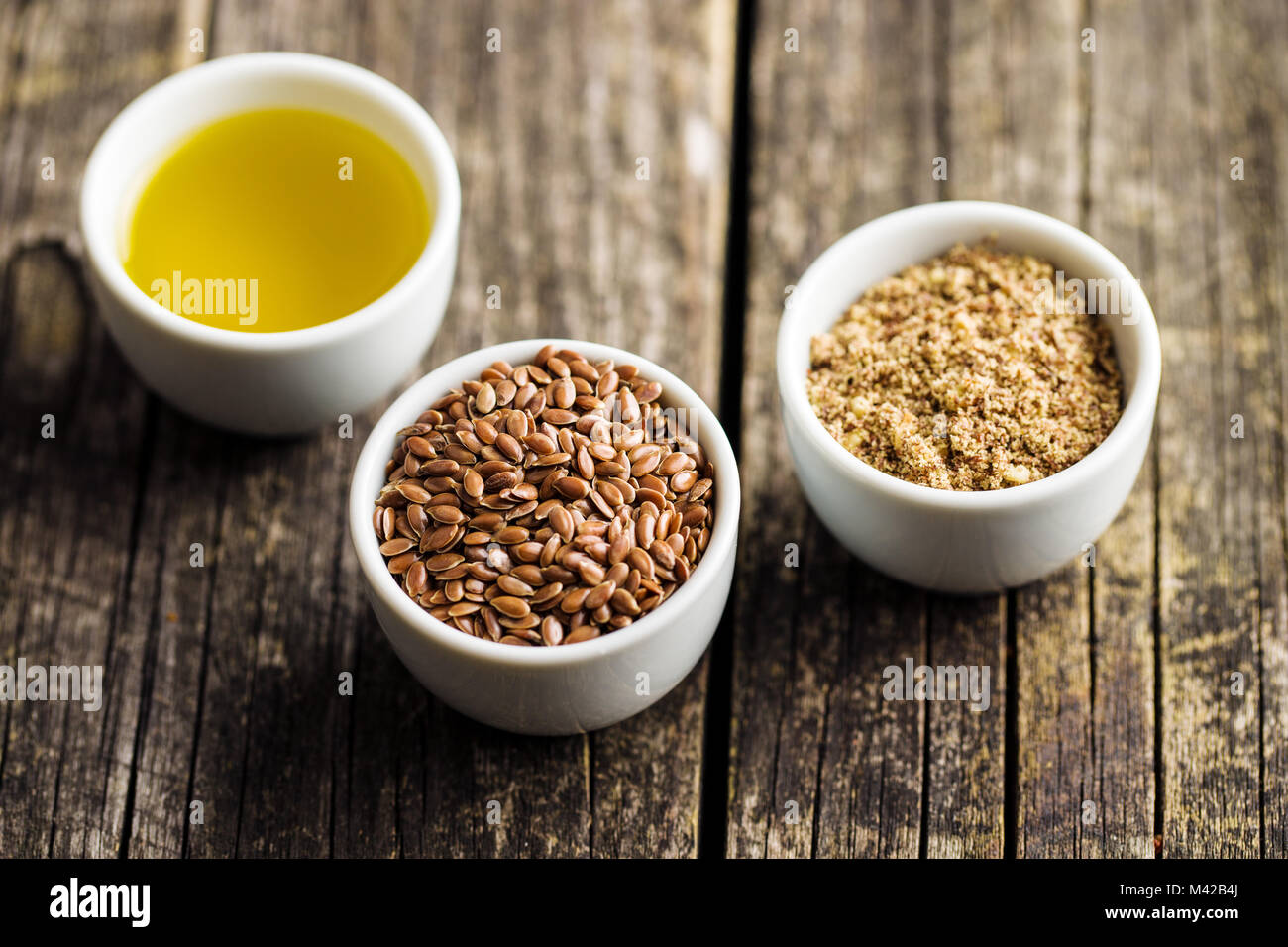 The healthy brown linseeds, minced linseed and oil. - Stock Image