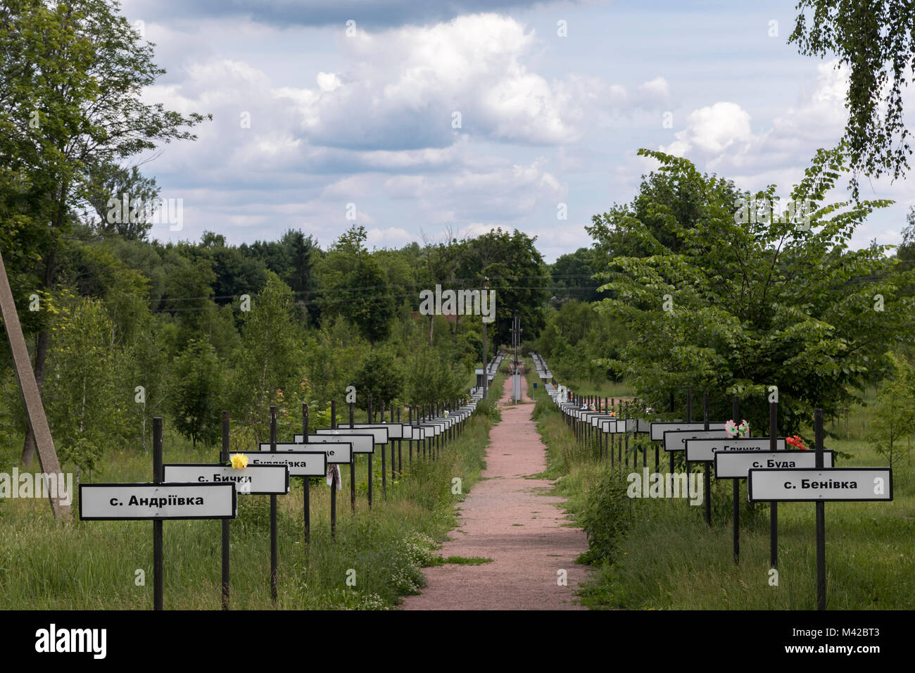 Crosses bearing the names of the villages evacuated after the Chernobyl nuclear accident in 1986 Stock Photo