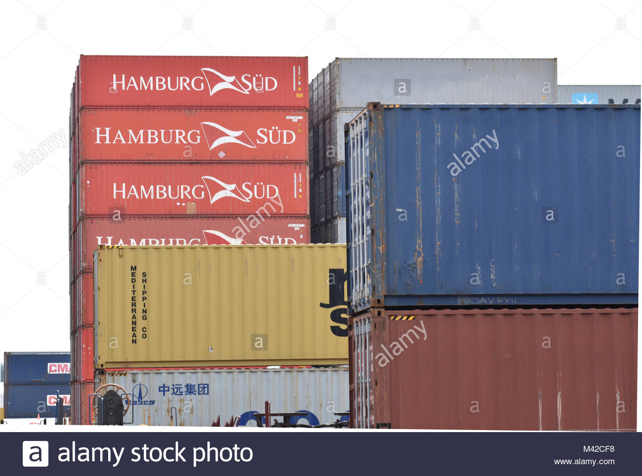 Intermodal containers stacked in rail yard - Stock Image