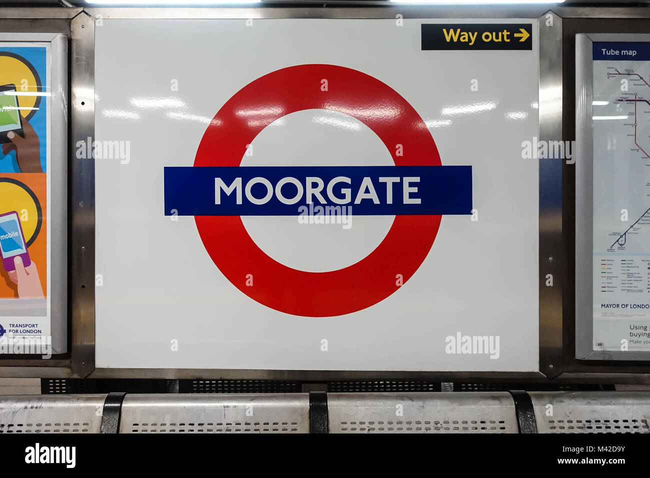 A close up view of a nameplate at Moorgate London Underground station. - Stock Image