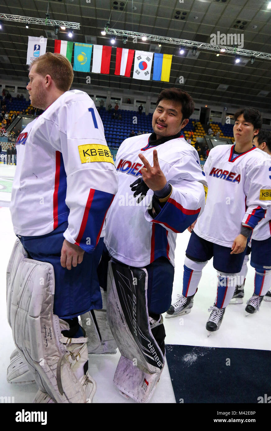 KYIV, UKRAINE - APRIL 28, 2017: Goalkeepers Matt DALTON (Left) and Sungje PARK of South Korea smile after IIHF 2017 - Stock Image
