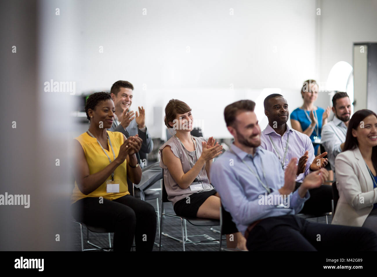 Audience at a conference applauding speaker - Stock Image