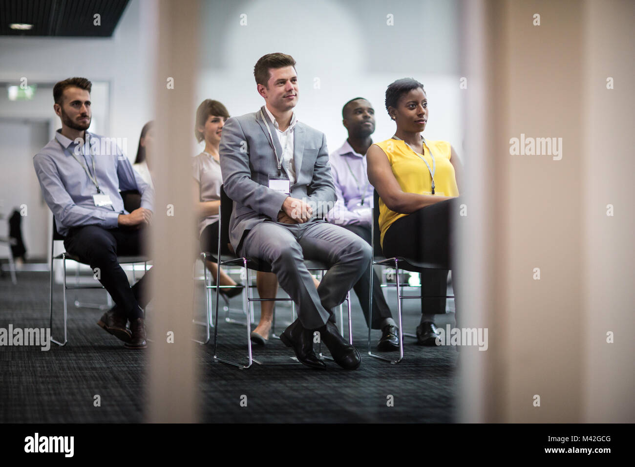 Audience listening at a business conference - Stock Image