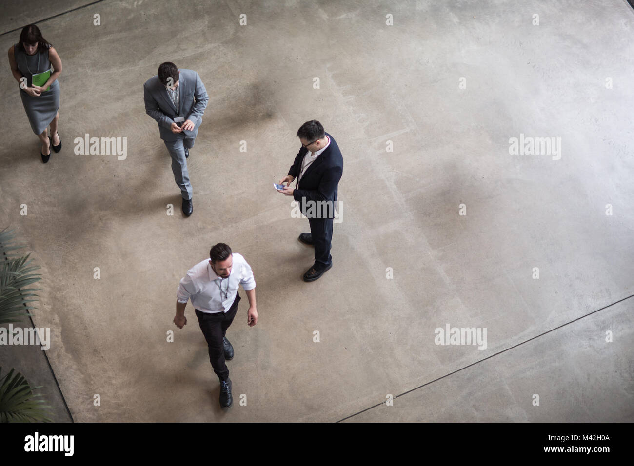Overhead shot of busy office lobby, atrium, reception - Stock Image