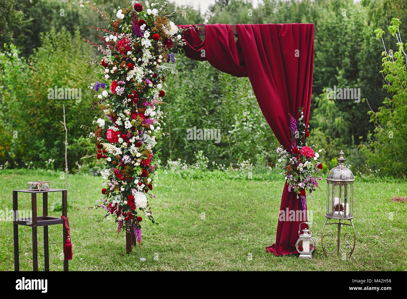 Wedding Arch With Vinous Curtain And Fresh Flowers Outdoors