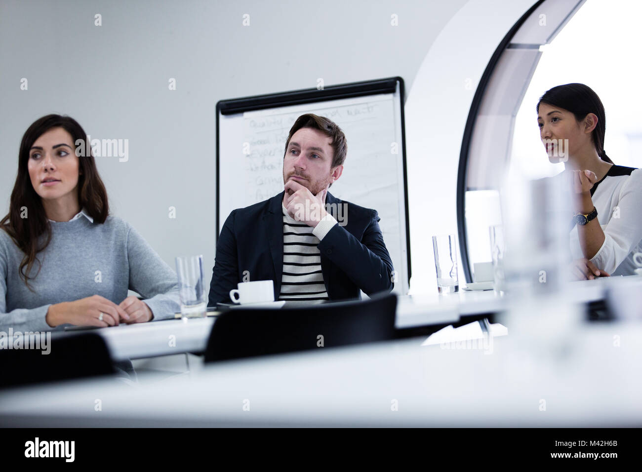 Colleagues listening in a business meeting - Stock Image