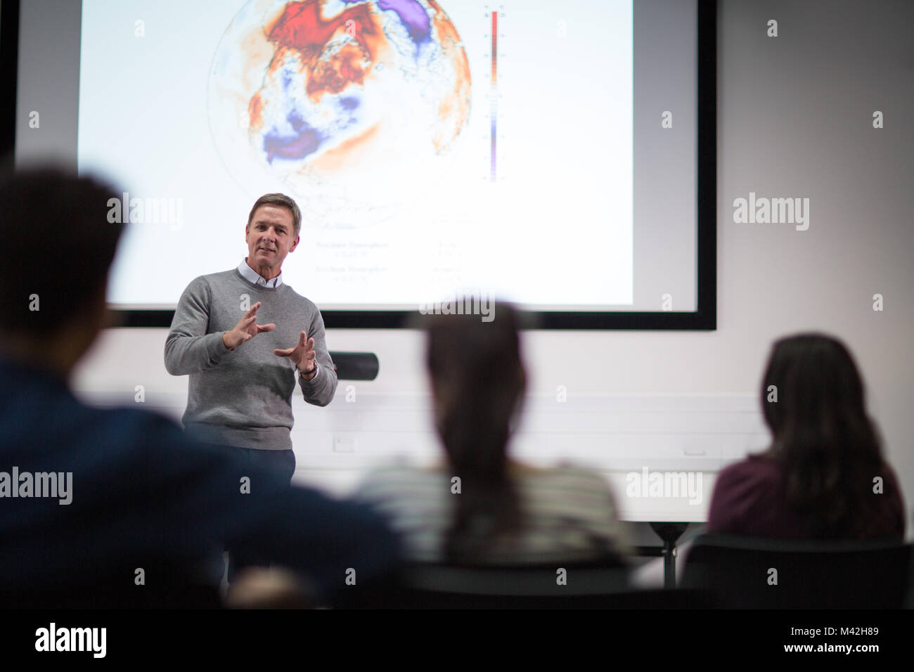 Teacher giving lecture at college - Stock Image