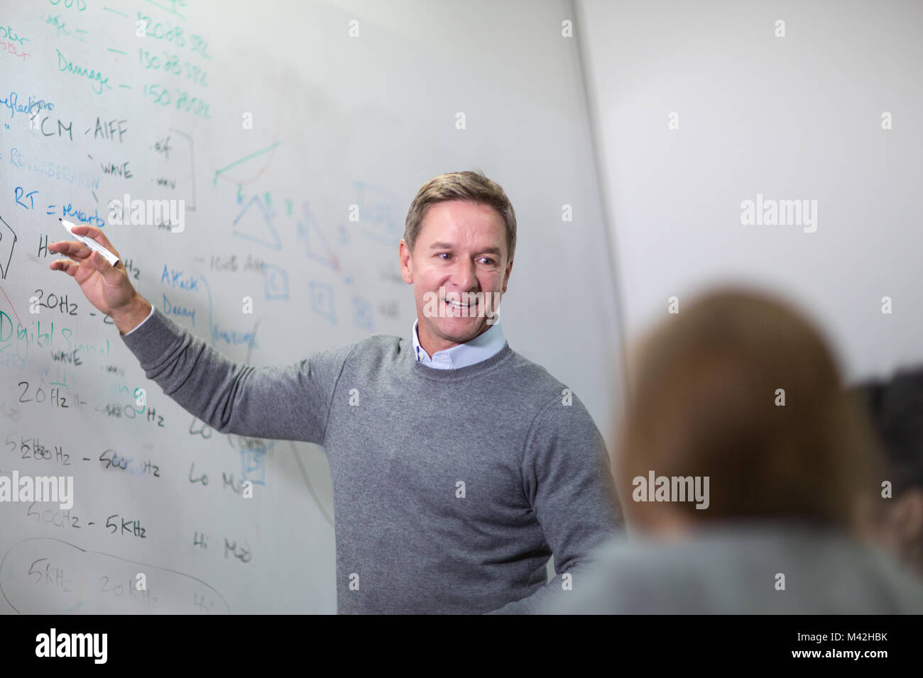 Teacher giving a class at college - Stock Image