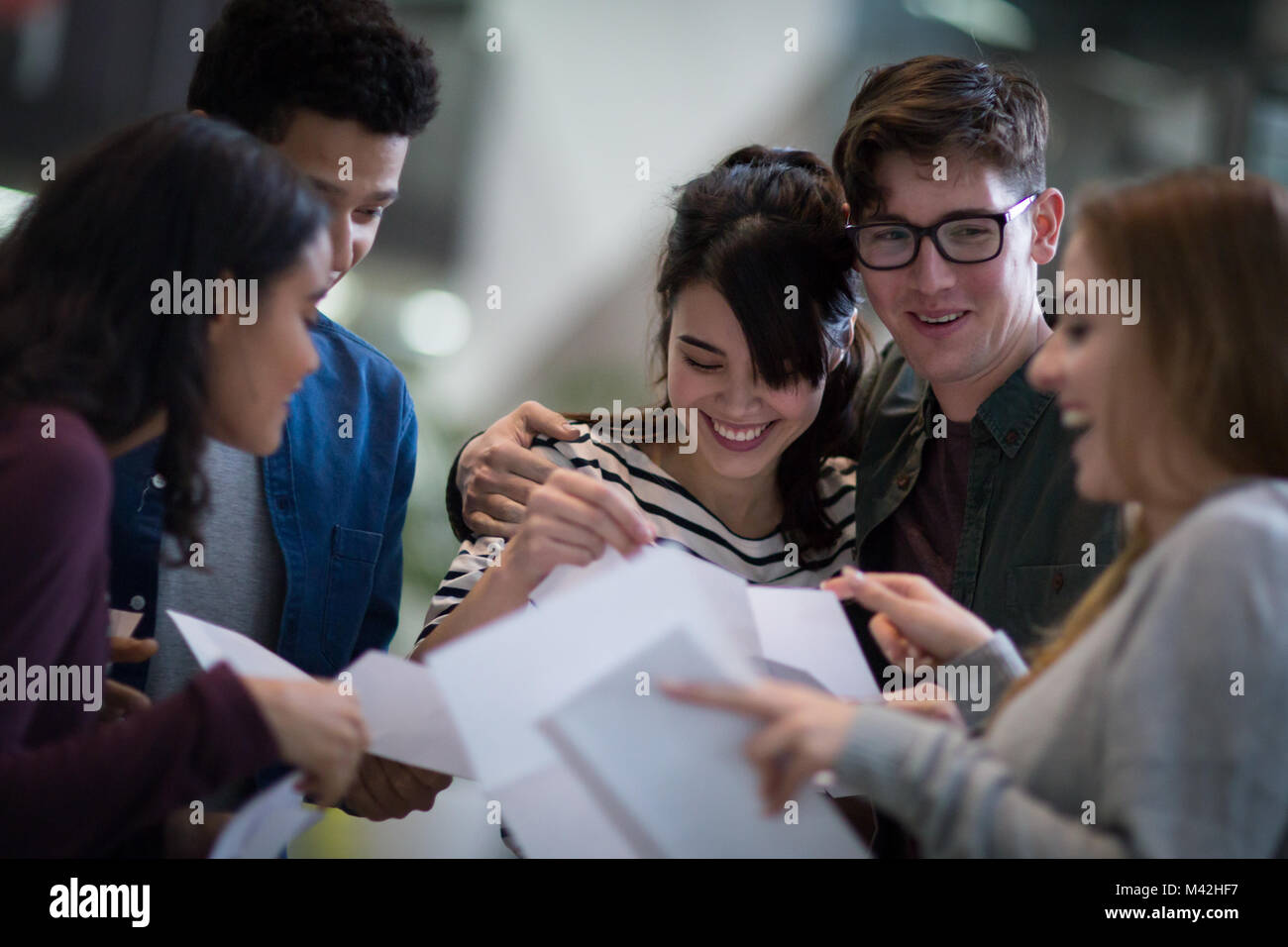 Students opening exam results - Stock Image