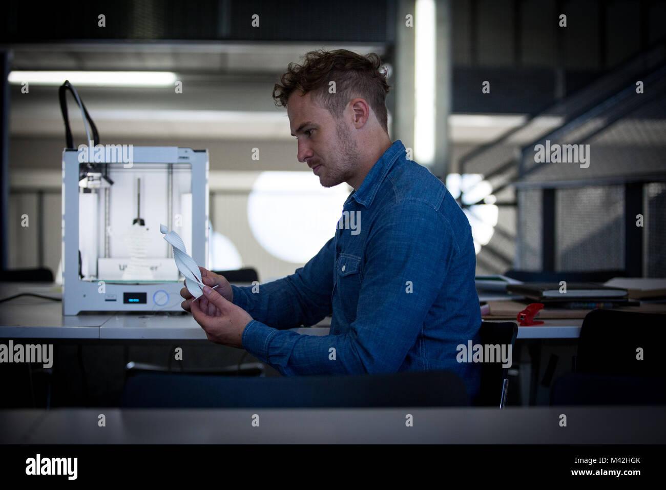 Designer with 3D printer - Stock Image