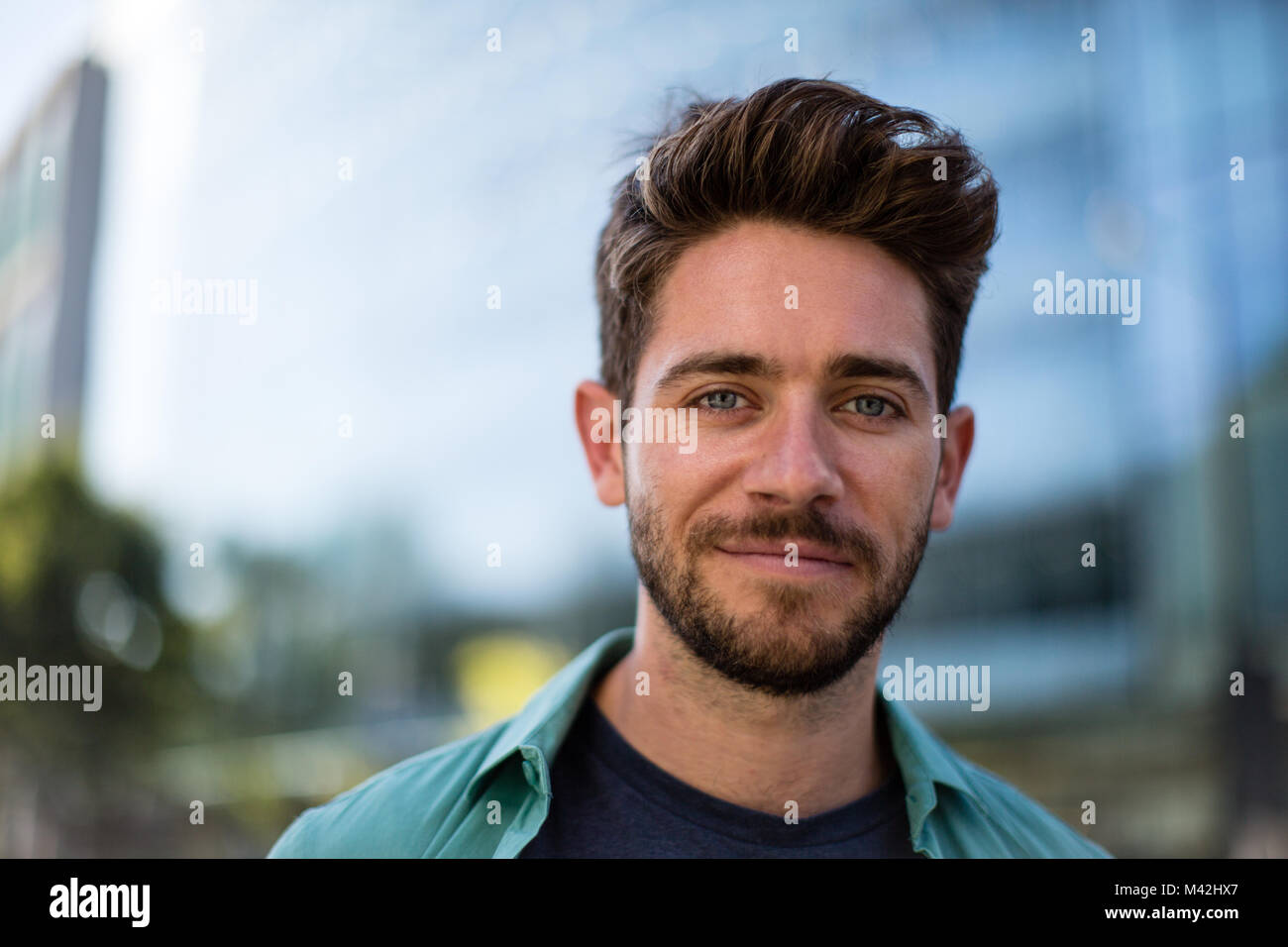 Portrait of young adult in modern city - Stock Image
