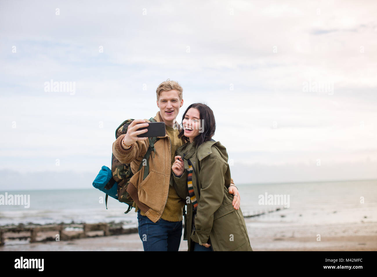 Young couple taking a selfie on a winter break - Stock Image