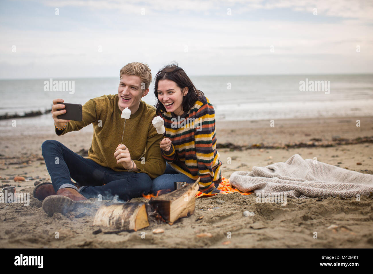 Young couple taking a selfie of their winter break - Stock Image
