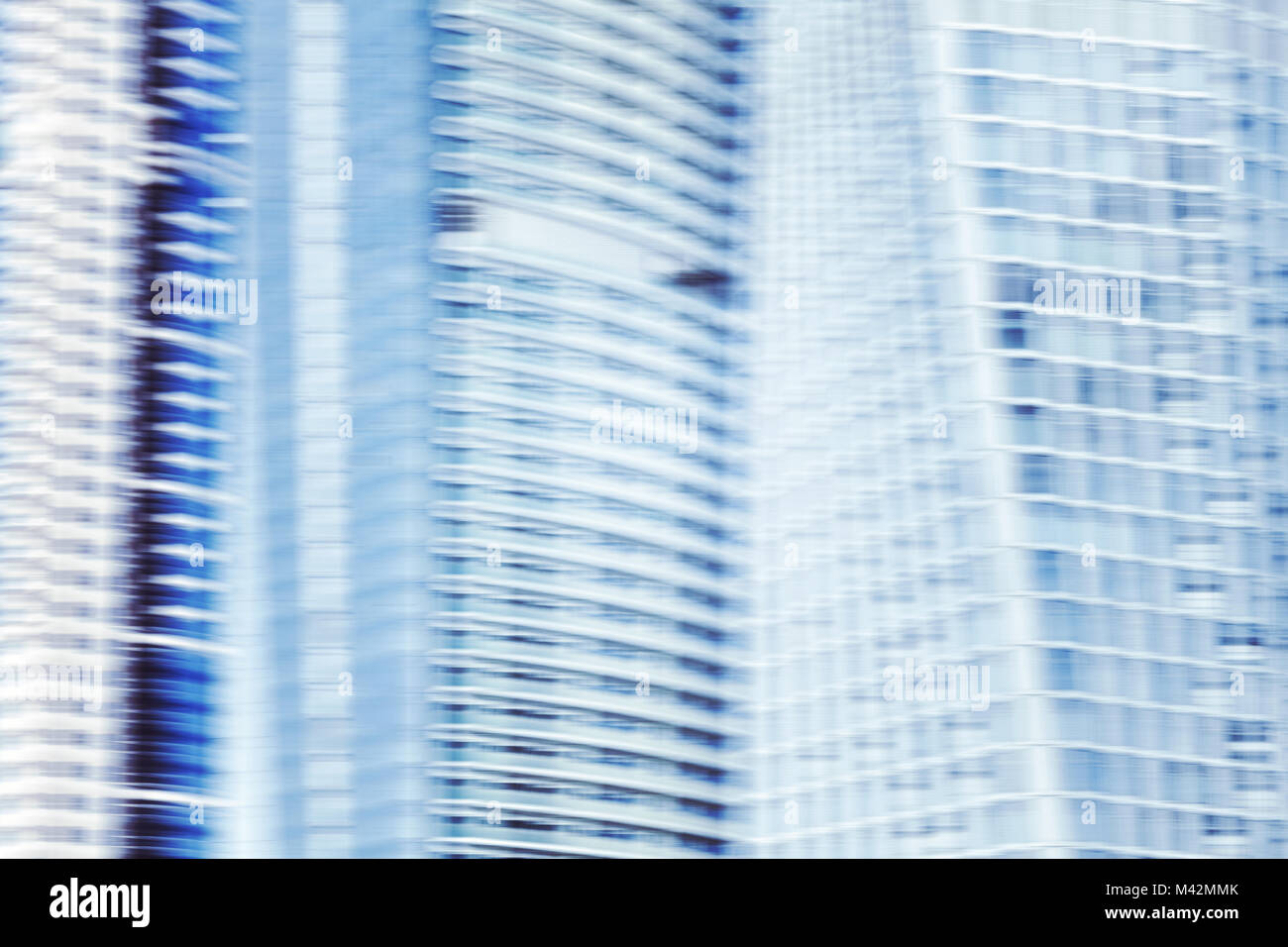 Abstract futuristic background made of motion blurred office buildings. - Stock Image