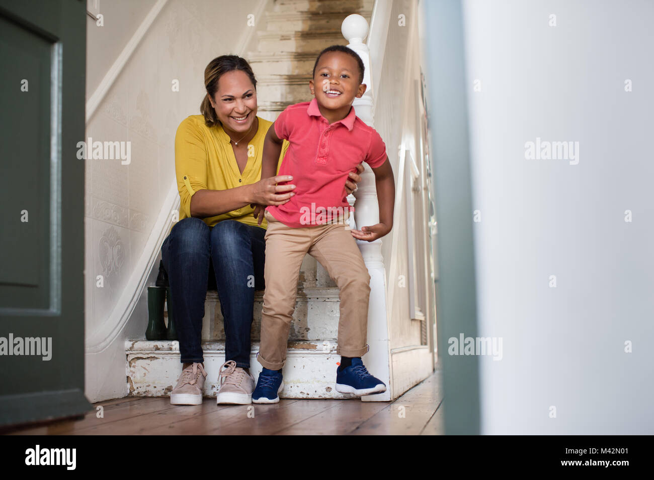 Boy excited to go to school - Stock Image