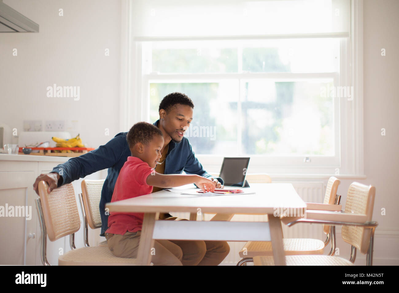 Father helping Son with school work Stock Photo