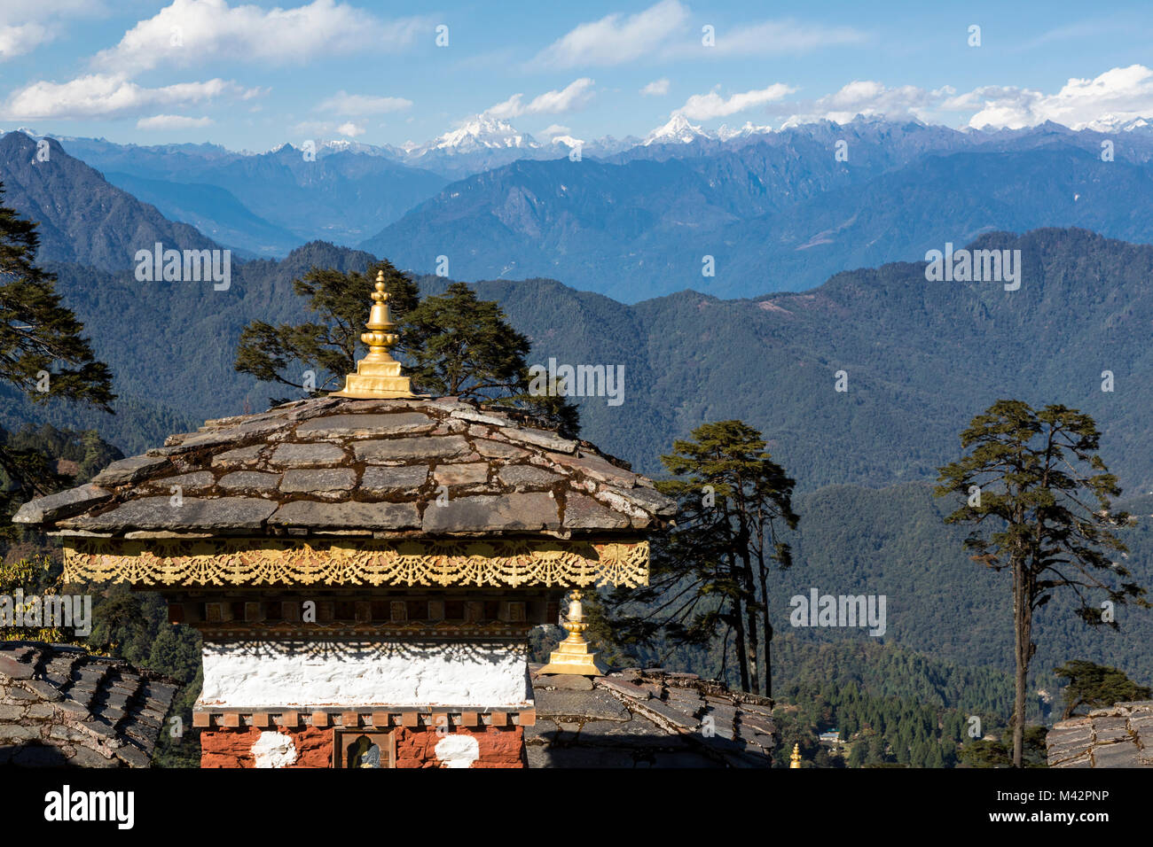 Punakha, Bhutan.  Chortens (Shrines) at a Mountain Pass in Himalayan Foothills; Himalayan Mountains in the Distance. - Stock Image