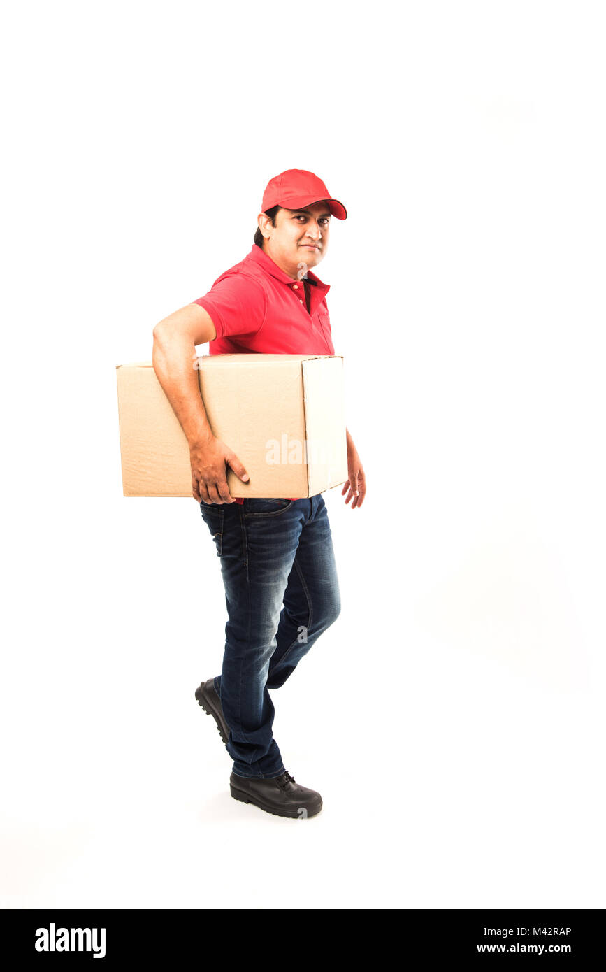 Delivery Concept - Portrait of Happy Indian or delivery man in red or green uniform walking or jumping or checking - Stock Image