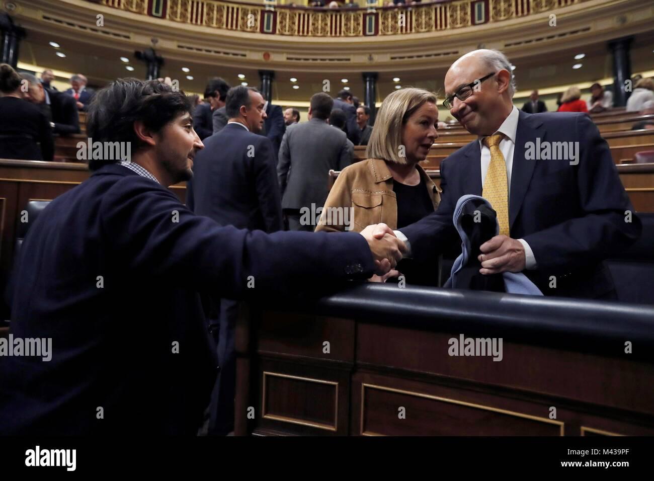 Madrid, Spain. 14th Feb, 2018. Spanish Treasure Minister, Cristobal Montoro (R), shakes hands with Ciudadanos party's - Stock Image